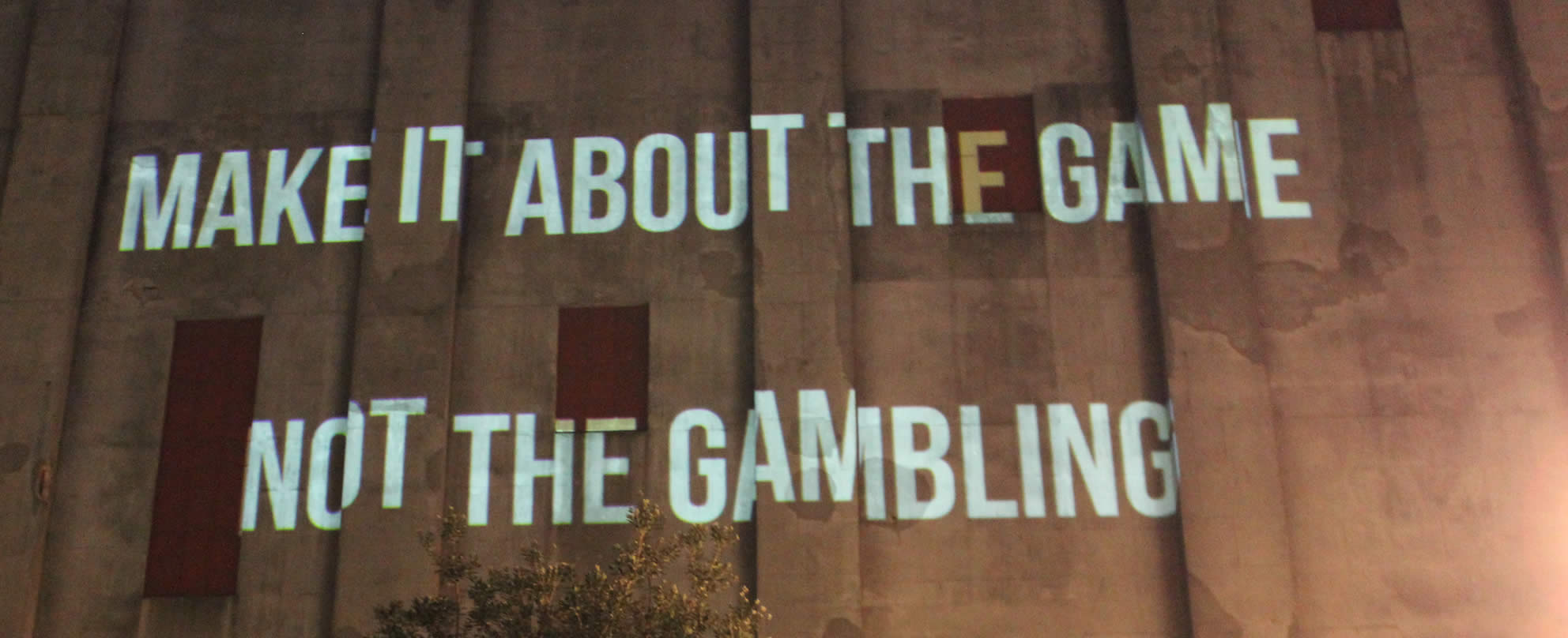 The campaign message projected onto a building in central Auckland