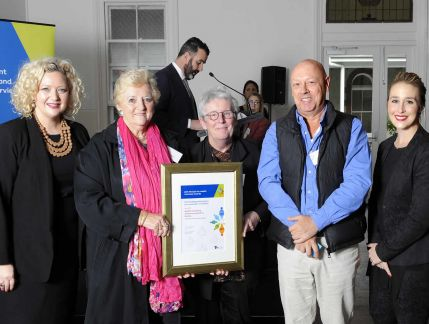 Minister for Health Jill Hennessy, ReSPIN speaker Pat Burns, ReSPIN coordinator Kate Sommerville, ReSPIN speaker David E and Parliamentary Secretary for Carers and Volunteers Gabrielle Williams. Pat and Kate are proudly holding up their award