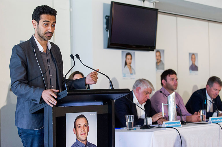 Responsible Gambling Awareness Week panel moderator Waleed Aly at lecturn