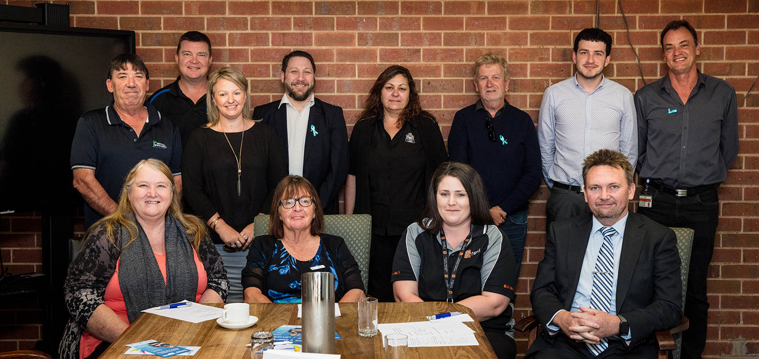 Group photo of seven men and five women, including representatives from seven local gambling-related business in the Swan Hill area