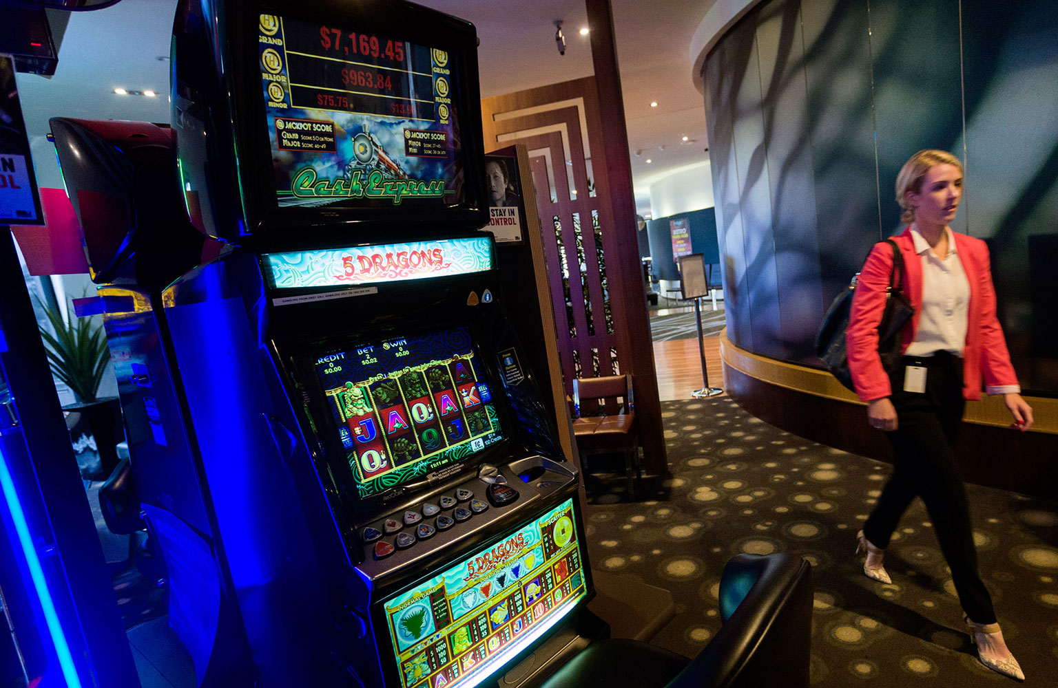 Patron walking through pokie venue