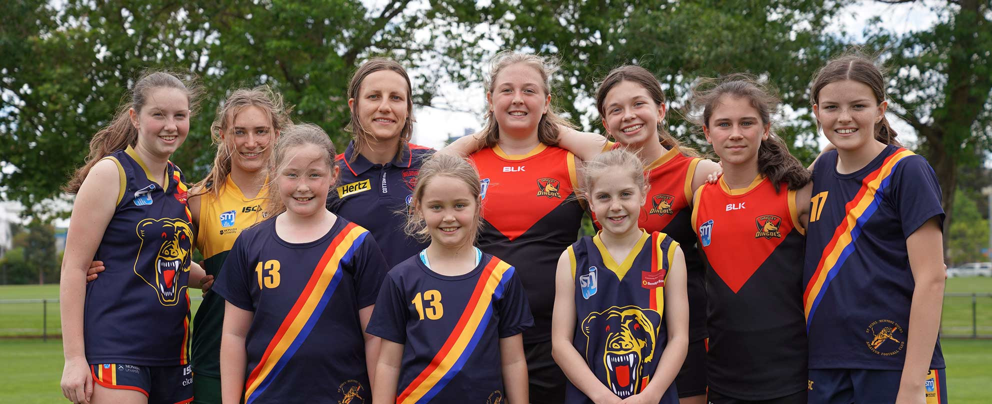 Demons AFLW player Karen Paxman (third from left, back) with girls from South Metro Junior Football League, photo: Melbourne Football Club
